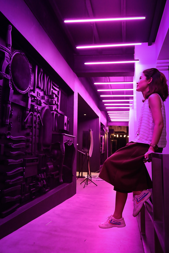 pink lit room with girl